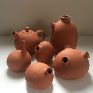 terracotta pinch and coiled stone shaped vessels